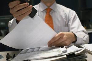 Businessman Stapling Documents